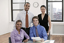 photo of business people sitting with a desk