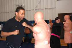 A course participant practices defensive techniques at the   CMSD Training class in Denver.