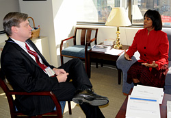 Supervisory TSO Sonja Armstrong talks with Security Operations Assistant Administrator Lee Kair at headquarters.