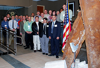 At TSA's Freedom Center, participants in the agency's first-ever Field Coordination Center Managers Training Seminar stand next to the 9/11 memorial.