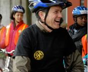 Acting Surgeon General Steven K. Galson rides a bicycle in a group of young people at the Bicycle Transportation Alliance event in Portland, OR.