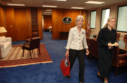 Secretary Sebelius and Chief of Staff Laura Petrou depart HHS for the White House. There, the Secretary attended a briefing on the latest news about the virus. (HHS Photos by Chris Smith)