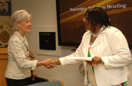 Before beginning the meeting, Secretary Sebelius went around the room to meet the team of leaders working on the outbreak response. (HHS Photos by Chris Smith)