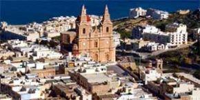 Date: 08/25/2003 Location: Malta Description: Aerial view of Mellieha village with its parish church, Malta. © AP Photo
