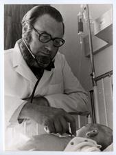 [C. Everett Koop examining an infant]. [ca. 1974].
