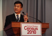 Locke at podium with 2010 Census logo.