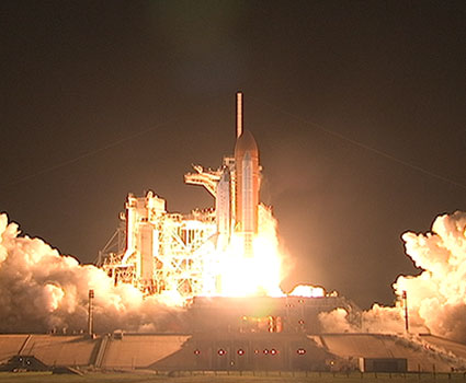 Space shuttle Discovery lifts off.