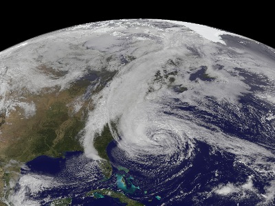"An image of Hurricane Sandy taken by the GOES-13 satellite on October 28.  This category 1 <a href=""/earth/Atmosphere/hurricane/hurricane.html"">hurricane</a> was huge, spanning a horizontal distance of about one-third the US continental landmass.  The storm came onshore in New Jersey, and gradually moved northeast.  The storm disrupted the lives of tens of millions in the eastern US, doing billions of dollars in damage, resulting in over 30 deaths.  Visit the National Hurricane Center's webpage on <a href=""http://www.nhc.noaa.gov/"">Hurricane Sandy</a> for details.<p><small><em>Image courtesy of NASA</em></small></p>"