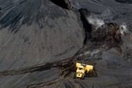 A bulldozer moves coal at the Foresight Energy mine in Carlinville, Ill.