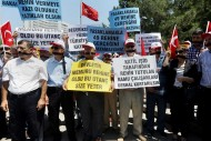 Civil servants stage a protest outside the Foreign Ministry in Ankara, Turkey, on July 17, demanding the release of 49 officials seized by Islamic militants in June at the Turkish consulate in Mosul, Iraq