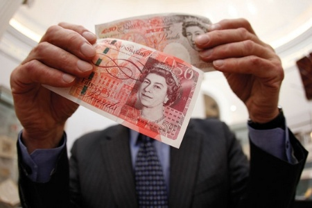 Man holding two fifty pound notes